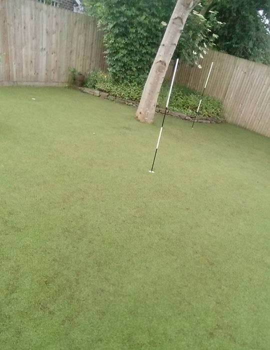 cleaned lawn with golf flag stick