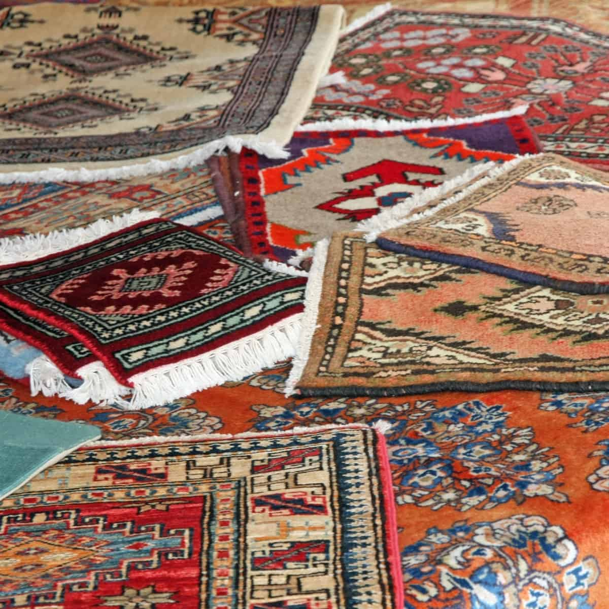 A collection of rugs together on the floor