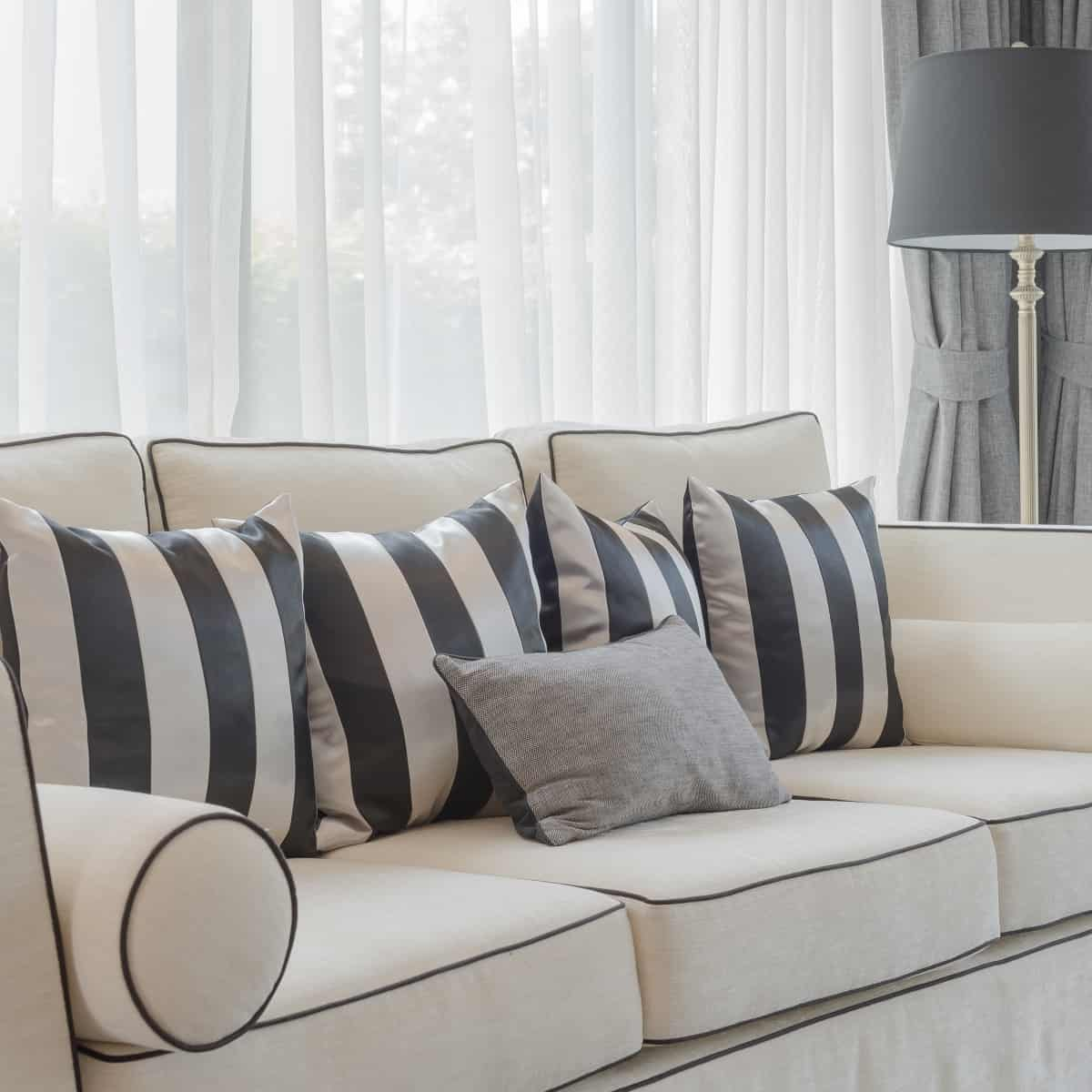 Clean white sofa with stripy cushions