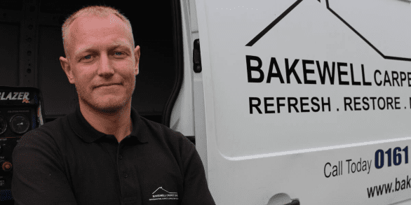 John Bakewell - Premium carpet cleaning Bury & Bolton, stood next to his van